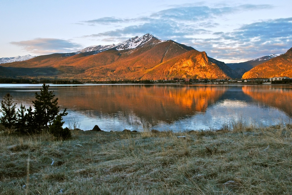Warm sun paints the face of Peak 1, while frost lingers in the morning shadows along Dillon Reservoir.