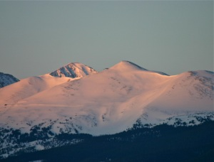 Morning alpenglow paints the summit of Breckenridge Ski Area.