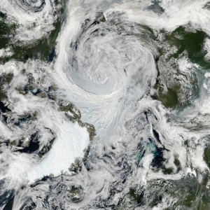 A cyclonic storm spins over the center of the Arctic Ocean. Photo courtesy NASA Earth Observatory