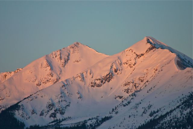A subtle pink sunrise glow suffuses the Tenmile Range near Frisco, Colorado.