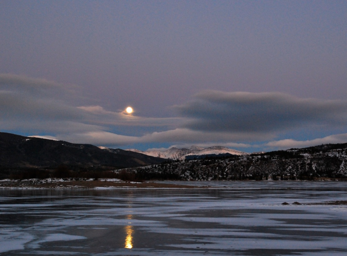 Tonight's full moon rise was fully obscured by clouds, so I reached back into the archives for moon shot.