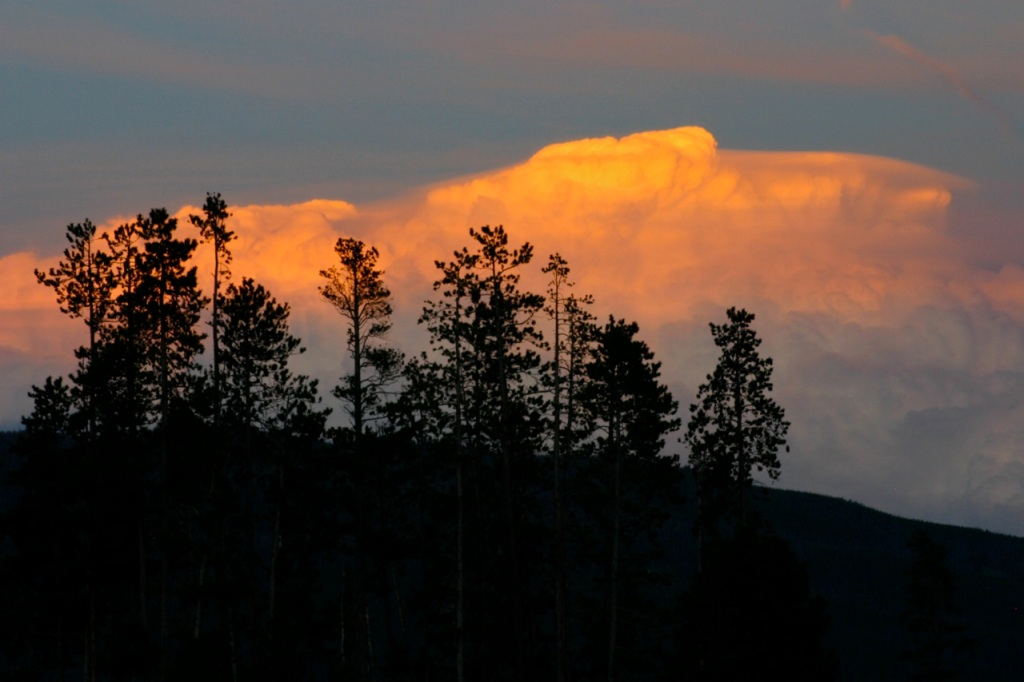 An impressive pile of clouds over the Continental Divide at sunset.