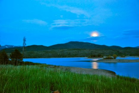A kind of weird low-light exposure of the moon rising above Dillon Reservoir.