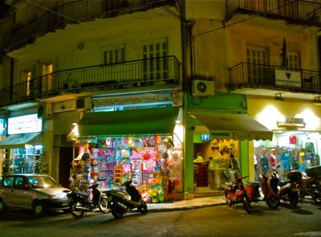 Visiting the corner store at night in Corfu, Greece.
