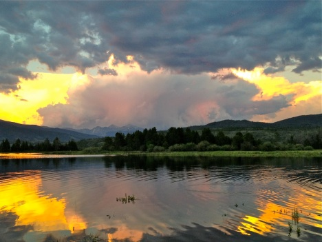 Unreal sunset over Dillon Reservoir, with lightning playing through the clouds.