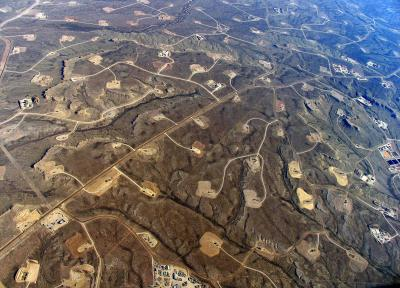 Caption: In areas where shale-drilling/hydraulic fracturing is heavy, a dense web of roads, pipelines and well pads turn continuous forests and grasslands into fragmented islands. Credit: Simon Fraser University PAMR