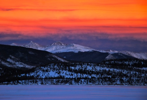 An other-worldly January susnet over Dillon Reservoir and the Continental Divide.