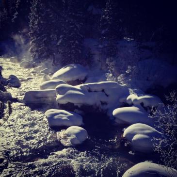 Morning sunlight streams into the Snake River Canyon near Keystone, Colorado.