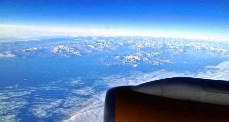 An Iceland Air jet flies over Greenland en route from Reykjavik to Denver. bberwyn photo.