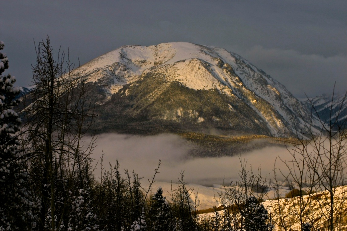 Low clouds hover over Silverthorne. Colorado with Buffalo Mountain as a backdrop.