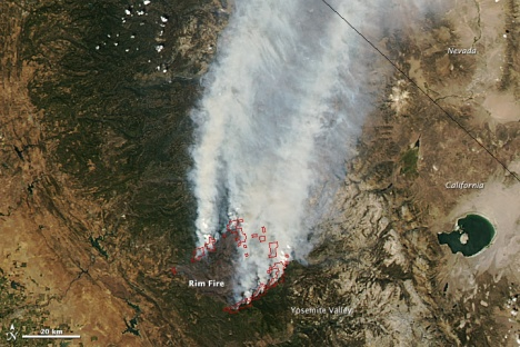 A NASA Earth Observatory image shows smoke plumes from the Rim Fire in August, 2013. NASA image by Jeff Schmaltz, LANCE/EOSDIS Rapid Response.