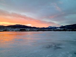 Early ice reflects sunrise colors near Frisco, Colorado.