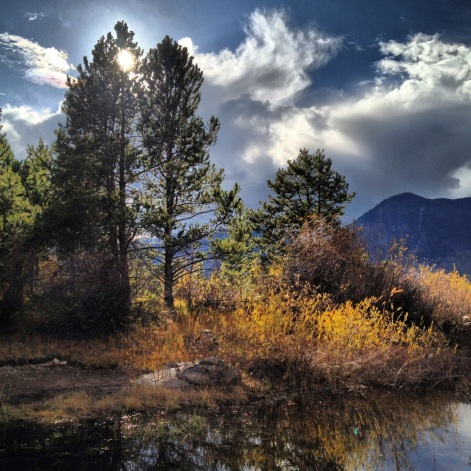 A moment of sunshine during an afternoon autumn thunderstorm in Frisco, Colorado.