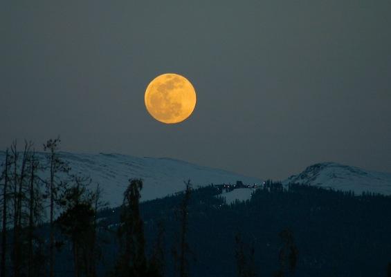 April full moon rising over Keystone Ski Area.