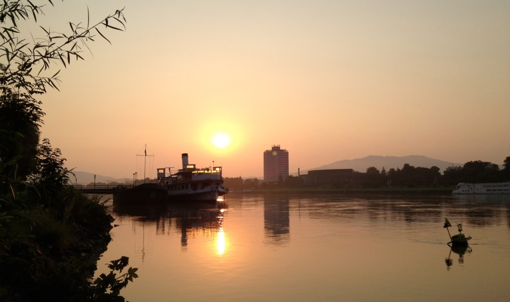 Sunrise along the Danube in Linz, Austria.