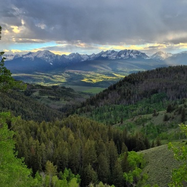 Late afternoon summer sunlight filtering into the Lower Blue River Valley, north of Silverthorne, Colorado.