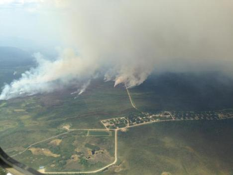 Spot fires show as small puffs of smoke ahead of the main fire front as the fire moves toward the New Town of the village of Nulato on June 22 Credit: Ben Pratt