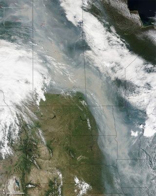 In late June, smoke from wildfires in Canada streamed down over North Dakota, South Dakota, Minnesota, and Iowa. Photo courtesy NASA Earth Observatory.