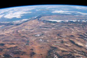 "This panoramic view of the southwestern United States and Pacific Ocean was taken by an astronaut looking out at an angle from the International Space Station (ISS). While most unmanned satellites view the Earth from a nadir perspective—collecting data while looking ""straight down""—astronauts onboard the ISS can acquire imagery at a wide range of viewing angles using handheld digital cameras."