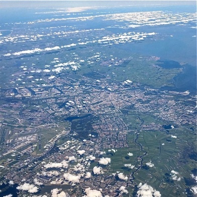 Amsterdam, recognizable by its distinctive pattern of canals, seen from a flight from Iceland to Frankfurt.