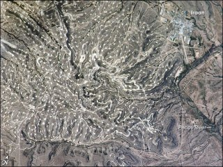 A West Texas oil field photographed from the International Space Station in 2006. Image courtesy NASA.
