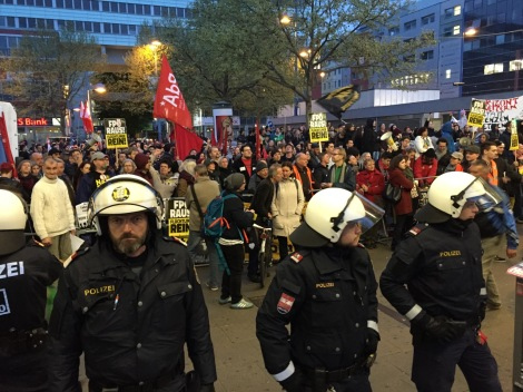 Police maintain a buffer zone between left- and right-wing demonstraters in Vienna.